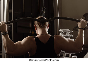 Guy training back muscles