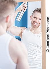 Guy using hair spray - Guy with stylish hair using hair ...