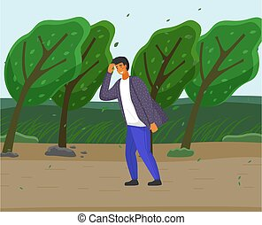 Guy walking along country road, strong gusts of wind will ...