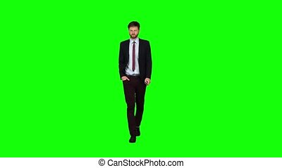 Guy walks down the street, puts his hand in his pocket and waves. Green screen