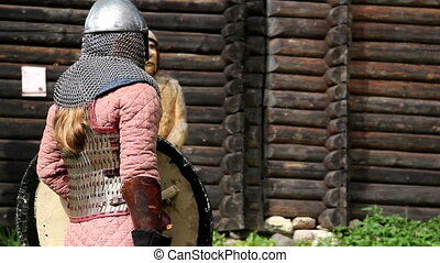 Guy wearing a medieval costume preparing a stance as if to...