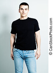 Guy Wearing Black T-Shirt and Blue Jeans