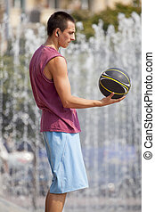 Guy with a basketball.