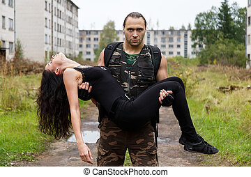 Guy with a girl on a battlefield