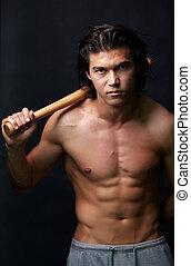 Guy with bat - Image of shirtless man with bat looking at ...