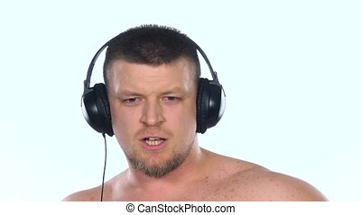Guy with headphones listening to music. White. Slow motion