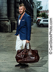 guy with leather bag