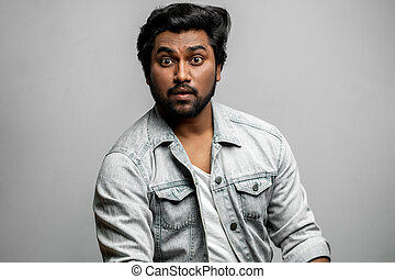 guy with surprised expression looking at the camera. how's that