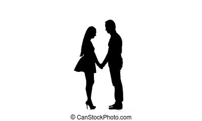 Guy with the girl hugs and looks at the sky. Silhouette....
