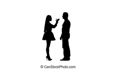 Guy with the girl swear and then they hug. Silhouette. White background. Slow motion