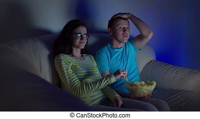 Guy with the girl watching a terrible and disgusting program...