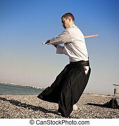 Guy working out aikido