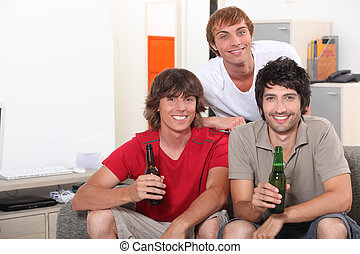 Guys drinking a beer