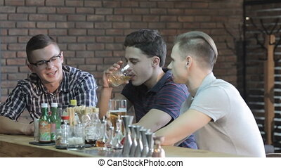 Guys talk at the bar