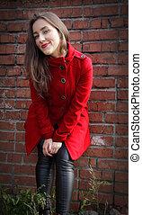 gyönyörű, leány, alatt, egy, piros bőr, képben látható, téglafal, háttér