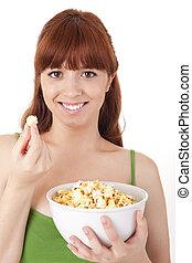 gyönyörű woman, étkezési, pattogatott kukorica