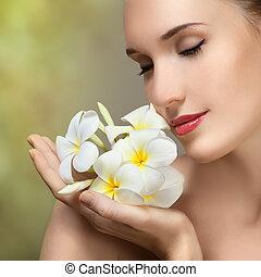gyönyörű woman, flower., szépség, fiatal, arc