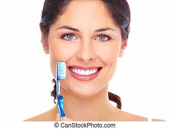 gyönyörű woman, mosoly, noha, egy, toothbrush.
