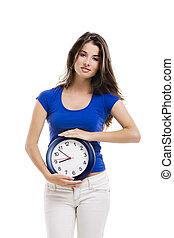 gyönyörű woman, noha, egy, óra