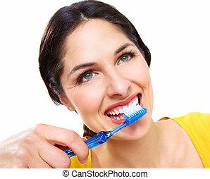 gyönyörű woman, noha, egy, toothbrush.
