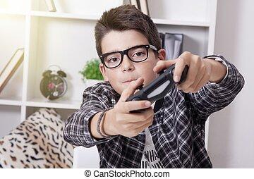 gyermek, otthon, játék, noha, a, video játék, vagy, játék...