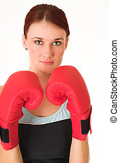 Gym #36 - A woman in gym clothes, with boxing gloves