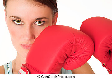 Gym #46 - Woman wearing boxing gloves. Looking serious.