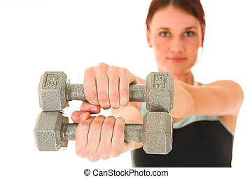 Gym #6 - A woman in gym clothes, holding weights out in ...