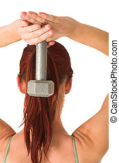 Gym #92 - Woman holding weight behind her head.