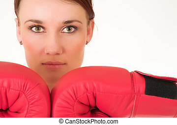 Gym - A woman in gym clothes, wearing red boxing gloves