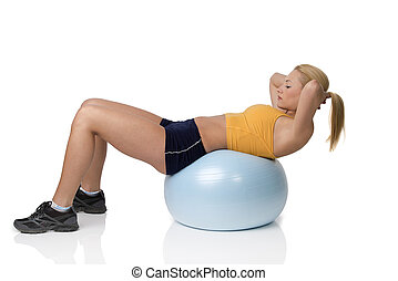 Gym blond girl on big ball