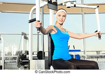 gym centre - Young sporty woman in the gym centre.