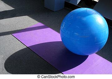 gym equipment - yoga ball and mat at the gym