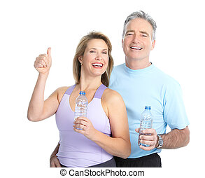 Gym & Fitness. Smiling elderly couple working out. Isolated ...