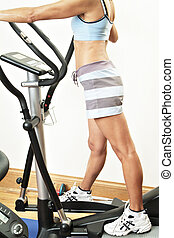 Gym Fitness - Woman using gym equipment
