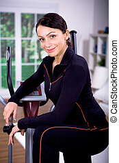 gym girl on cross-trainer