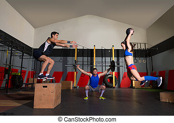 gym group workout barbells slam balls and jump - gym people ...