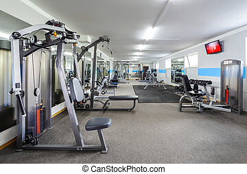 Gym interior with sports equipment.