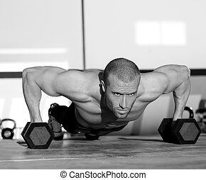 Gym man push-up strength pushup with dumbbell - Gym man...