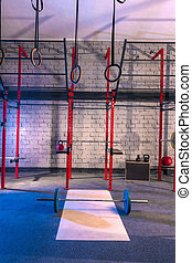 Gym nobody with barbells kettlebells and bars