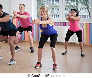 Gym people doing squats