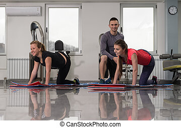 Gym People Stretching And Looking Very Happy