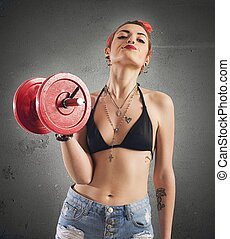 Gym pin-up - Pin-up girl with tattoo lifting a weight