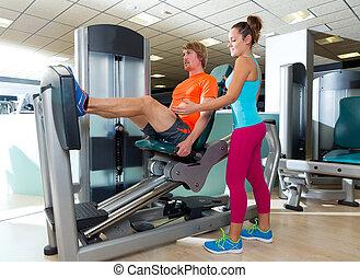 Gym seated leg press machine blond man workout and personal...