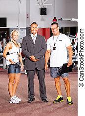 gym staff full length portrait