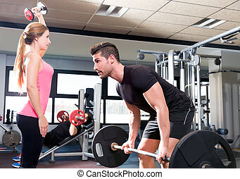 Gym weightlifting couple workout barbell dumbbell - Couple...