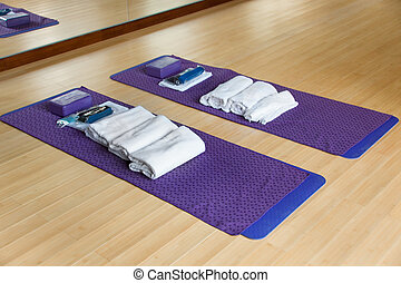 Gym with mat and other exercising materials prepared for ...