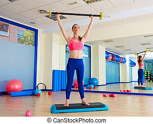 Gym woman barbell exercise workout at gym