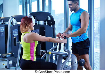 woman exercising with her personal trainer - Gym woman ...