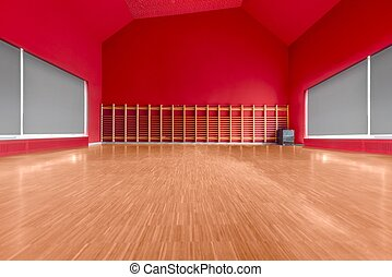 Gymnasium room with red wall and wooden floor